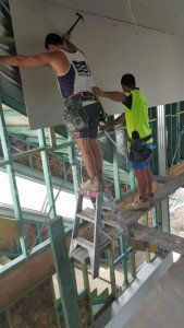 Plasterers up high.