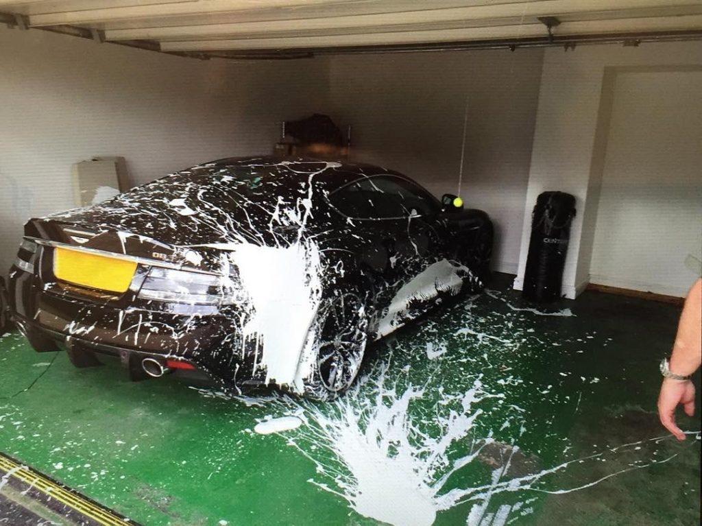 Aston Martin splattered with paint